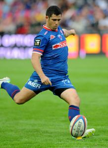 Grenoble s French fly half Valentin Courrent hits a penalty