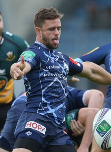 Rory Kockott kicks Castres v Northampton Saints