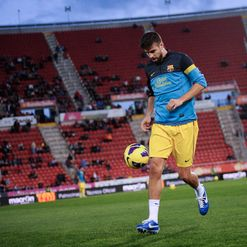 Pique: Back in training for Barcelona