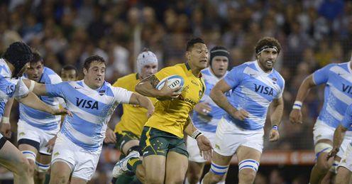 Australia s Wallabies fullback Israel Folau C runs amidst Argentina