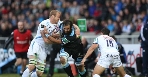Josh Strauss of Glasgow Warriors is tackled by Damian Welsh of Exeter Chiefs