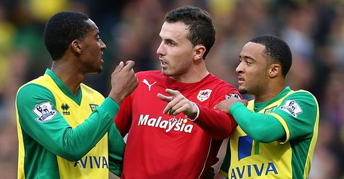 Norwich v Cardiff Leroy Fer and Nathan Redmond speak with Jordon Mutch