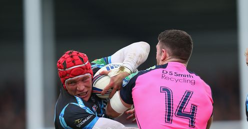 Tom Johnson of Exeter Chiefs forces his way through the challenge of Alex Cuthbert R and Cory Allen L