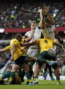 England players charge down a kick from Australia s scrum half Will Genia leading to an England try