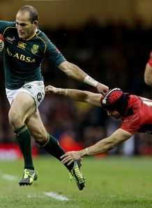 Fourie Du Preez of South Africa beats Leigh Halfpenny of Wales