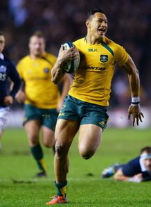 Israel Folau of Australia breaks free v Scotland