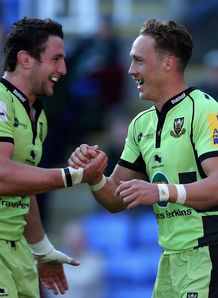 James Wilson of Northampton is congratulated by his captain Phil Dawson