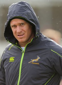 Jean de Villiers of South Africa warms up rain