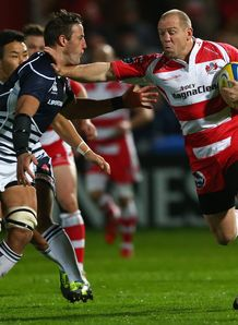 Justin Ives L of Japan challenges Mike Tindall R of Gloucester