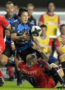 Montpellier s Fran ois Trinh Duc C is tackled by Grenoble