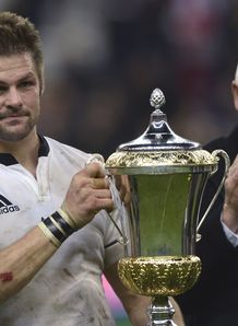 New Zealand s flanker Richie McCaw holds the Dave Gallaher trophy