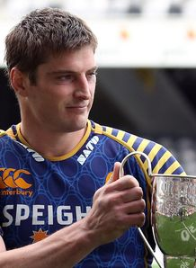 Otago captain Paul Grant holds aloft the Lyn Colling Memorial Cup