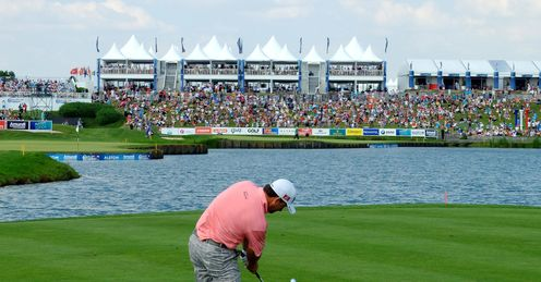 Graeme McDowell chips over the water at Le Golf National, the venue for the 2018 Ryder Cup
