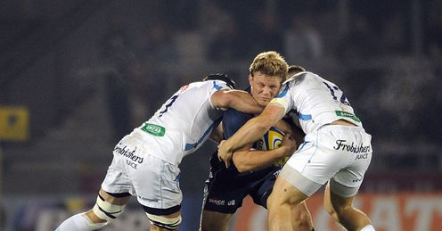 Dan Braid of Sale Sharks is tackled by Exeter Chiefs