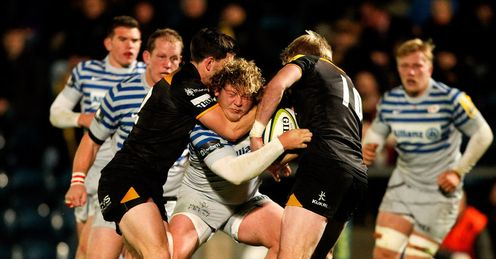 Jared Saunders of Saracens is tackled v Wasps during LV Cup match