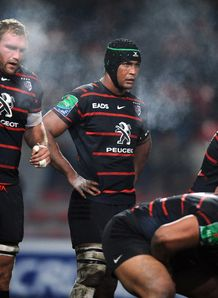 Toulouse s flanker Thierry Dusautoir C and his teammates