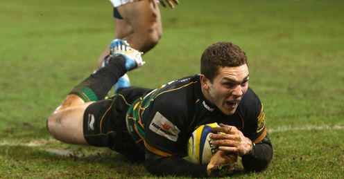 George North of Northampton dives over for the final try