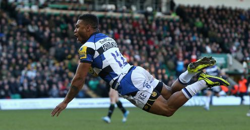 Kyle Eastmond of Bath dives over for the first try