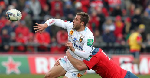 Perpignan s Tommaso Benvenuti L is tackled by Munster s Paul O Connell