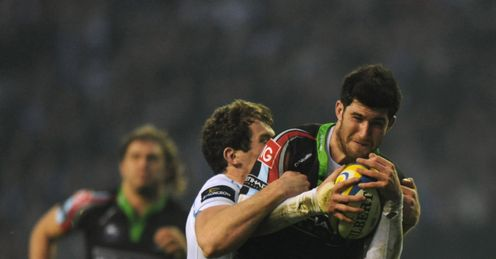 Tom Casson of Harlequins is tackled by Ian Whitten of Exeter Chiefs