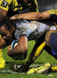 Bayonne s center Gabiriele Lovobalavu L is tackled by Clermont