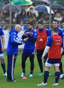France assistant coach Patrice Lagisquet L talks to his players