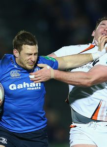 Jimmy Gopperth L of Leinster is held up v Ospreys