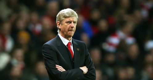 Second: Arsene Wenger's side are down to second - but it's not over yet, says Jamie
