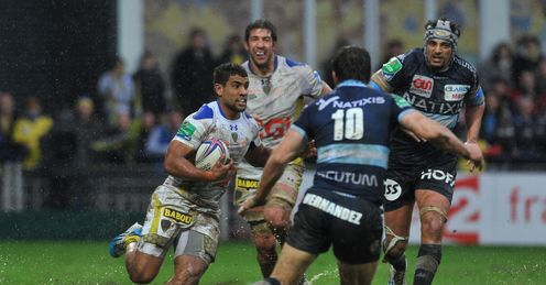 Clermont s French centre Wesley Fofana L runs with the ball