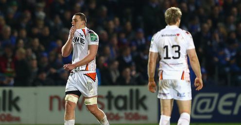Ian Evans L of Ospreys shows his dejection after being shown a red card