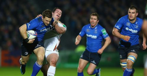 Jimmy Gopperth L of Leinster is held up by Ryan Bevington