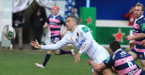 Perpignan s French centre Karl Chateau L is tackled by Gloucester s British flanker Matt Cox