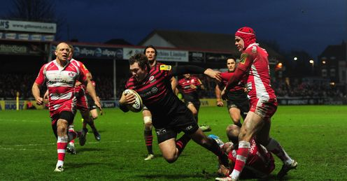 Saracens player Alex Goode goes over for the third try
