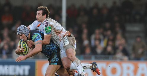 Tom Jones of Exeter Chiefs is tackled by Tom Grabham of Ospreys