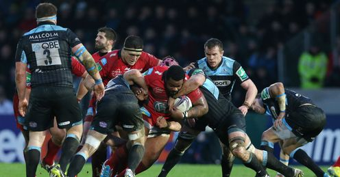 Toulon s Mathieu Bastareaud C is stopped by the Glasgow Warriors defendce
