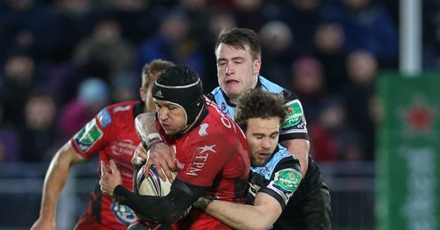 Toulon s Matt Giteau L is tackled by Glasgow Warriors Ruaridh Jackson R and Glasgow Warriors Stuart Hogg C