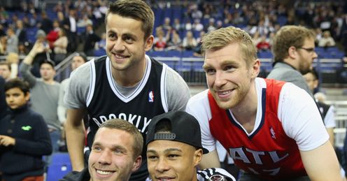 Football fans: the Arsenal quartet are at the NBA London game, but will they watch every game if it arrives?