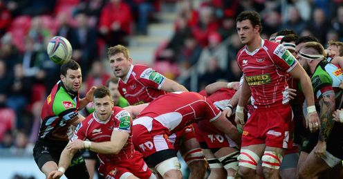 Gareth Davies of Scarlets passes the ball during the Heineken Cup Pool 4 match between Scarlets and Harlequins