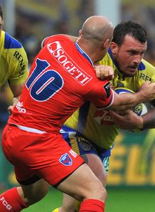 Clermont prop Thomas Domingo is tackled by Grenoble