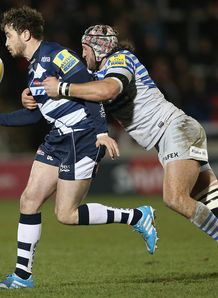 Danny Cipriani of Sale attempts to move away from Jacques Burger of Saracens 2014