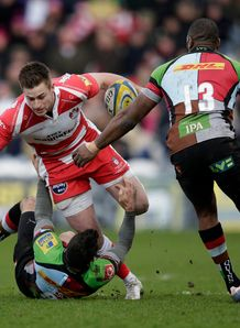 Gloucester fly half Ryan Mills brought to ground