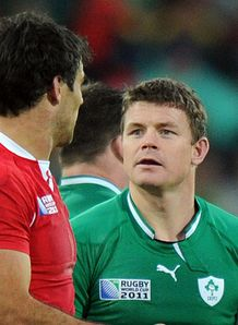Ireland s center Brian O Driscoll R looks at Wales scrum half Mike Phillips