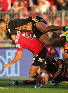 Israel Dagg of the Crusaders is tackled by Augustine Pulu of the Chiefs
