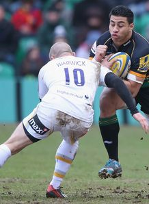 Northampton Saints centre George Pisi taking contact