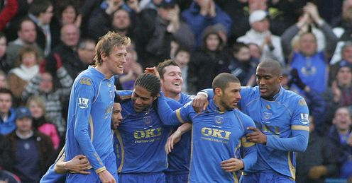 Portsmouth: former stars Peter Crouch, Glen Johnson and Sylvain Distin celebrate against Man City in 2009.