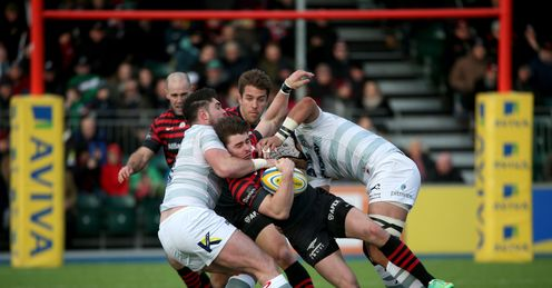 Ben Ransom of Saracens takes on the London Irish defence