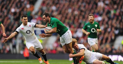Ireland wing Dave Kearney is tackled by Billy Twelvetrees as Danny Care l looks on