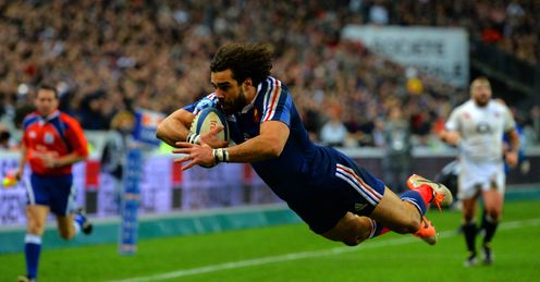 France Jean Marc Doussain of France goes over to score their second try