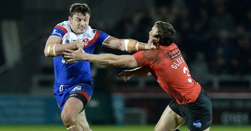 St Helens Jon Wilkin is tackled by Salford Red Devils Martin Gleeson 2014