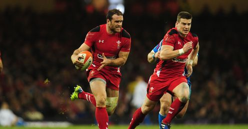 Wales player Jamie Roberts l makes a break before setting up Scott Williams r for the second Wales try